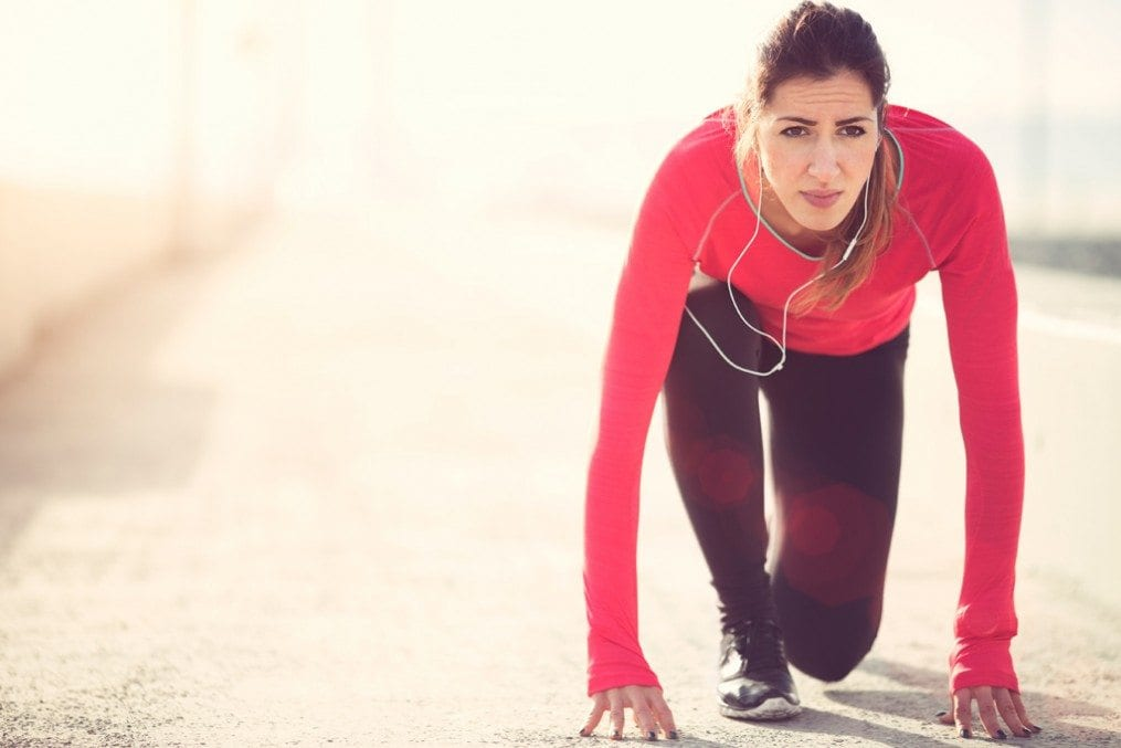 Competitive woman about to go for run