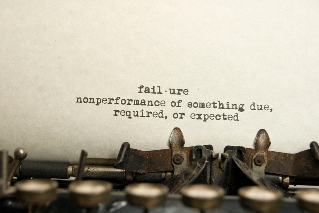 Failure written on paper of typewriter