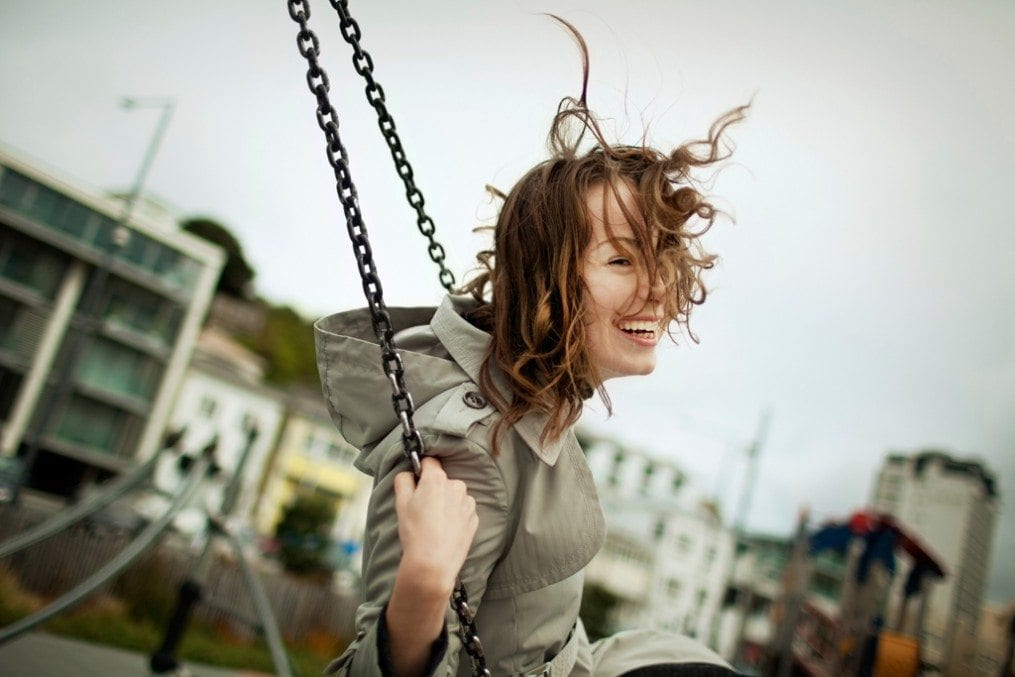 Happy woman on swing