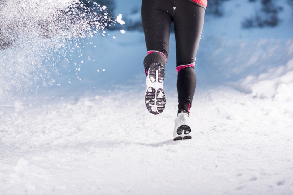 Woman doing HIIT in snow