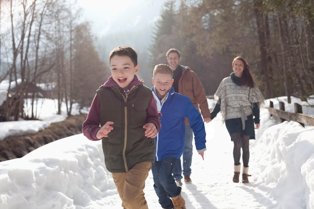 Family fitness - family playing in snow