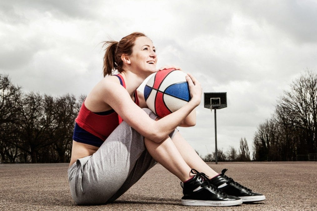 woman holding a netball
