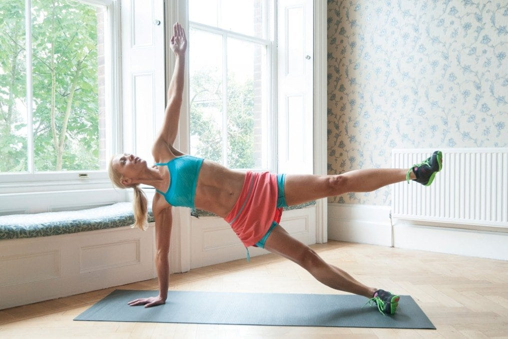 woman going stretches on exercise mat