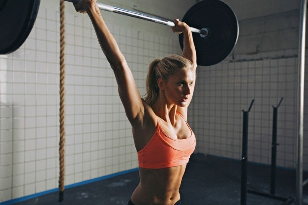 Woman lifting weights above head