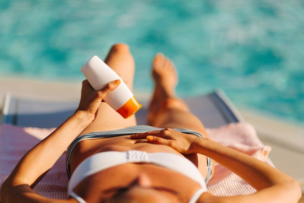 Woman applying sun cream