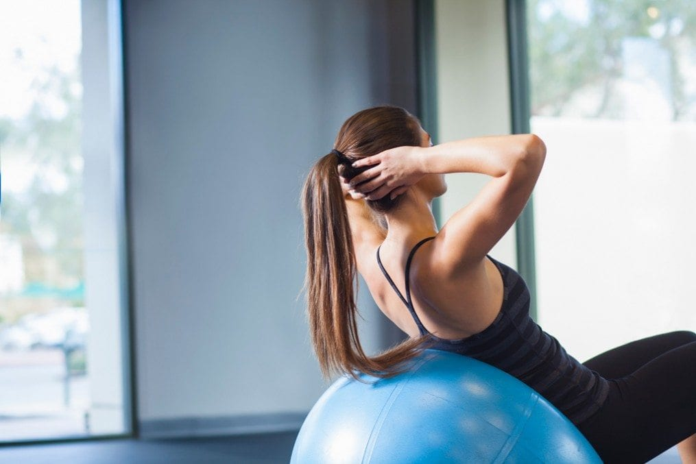 woman working on core strength with exercise ball