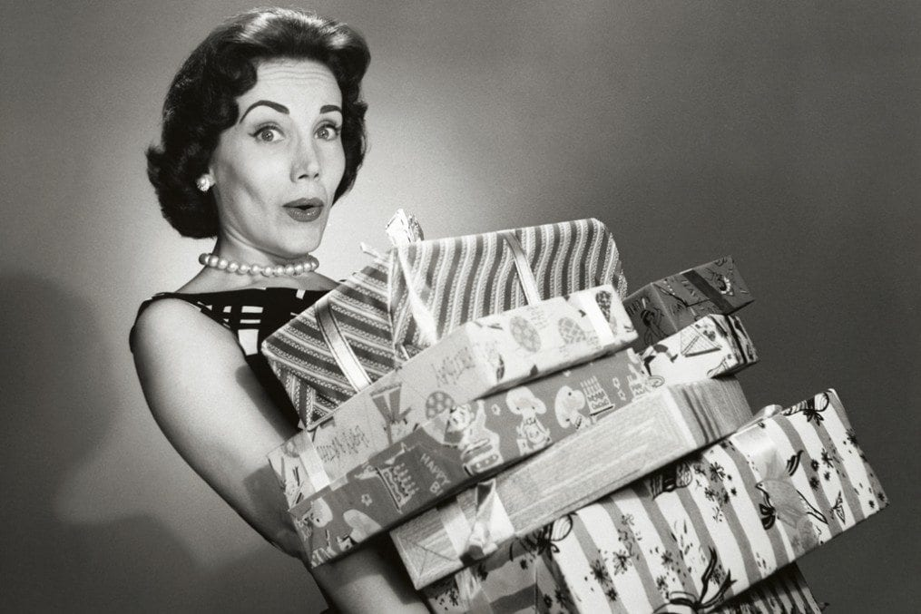 Woman carrying lots of christmas presents