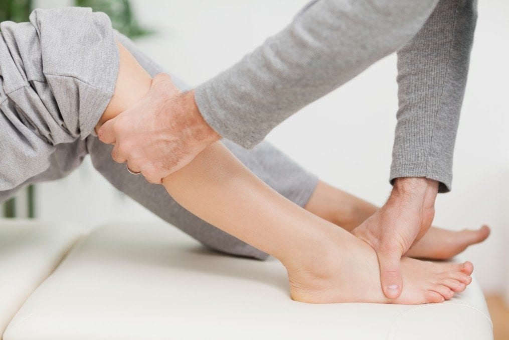Woman receiving physiotherapy on her leg