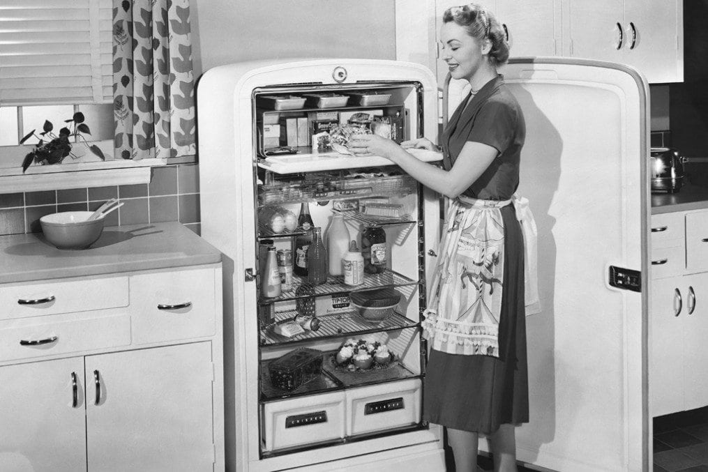 old fashioned image of woman in kitchen