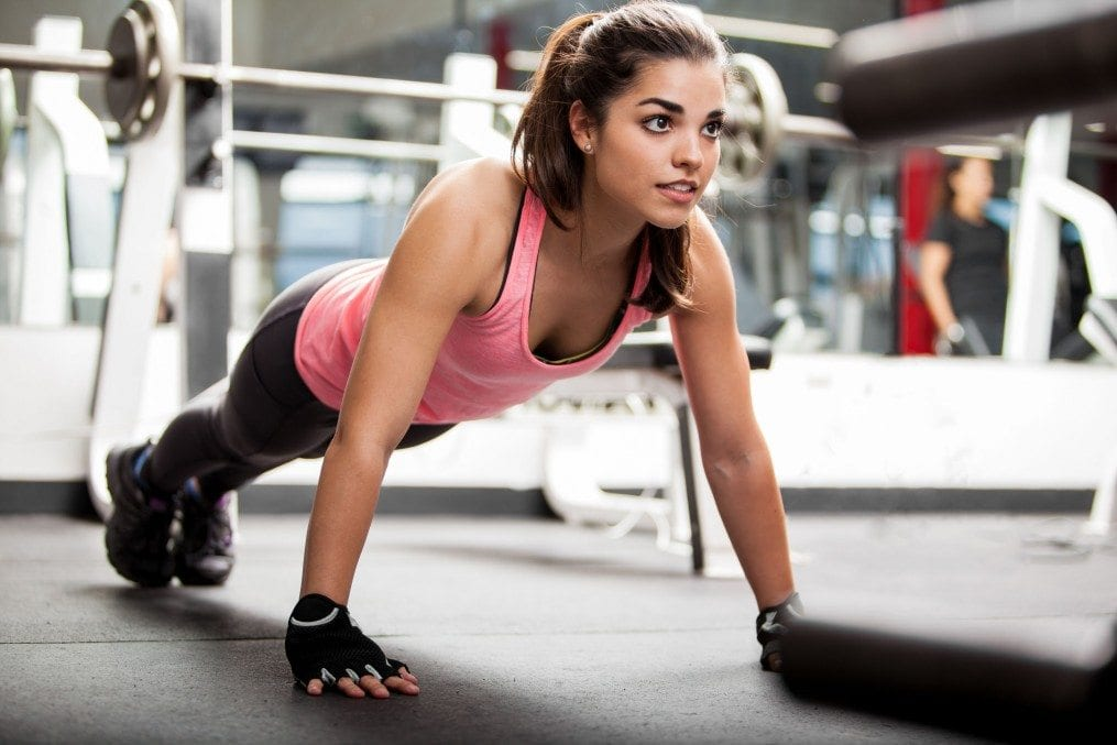 Woman in workout gear doing push ups