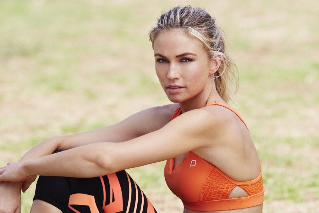 Woman in orange and black fitness gear