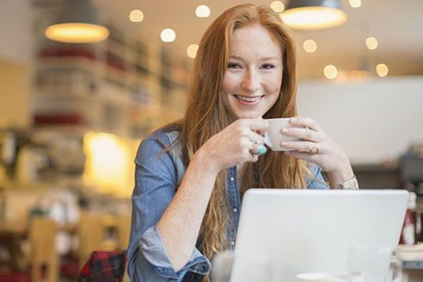 woman in cafe on laptop