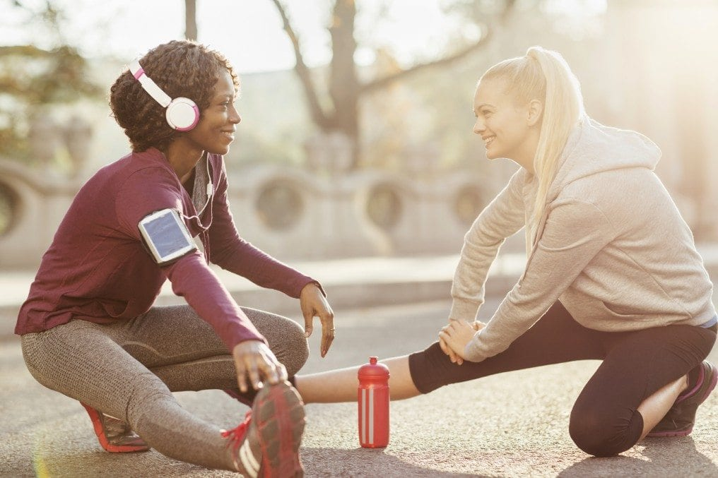 free_iStock_000055498268_Large.jpg friends stretching