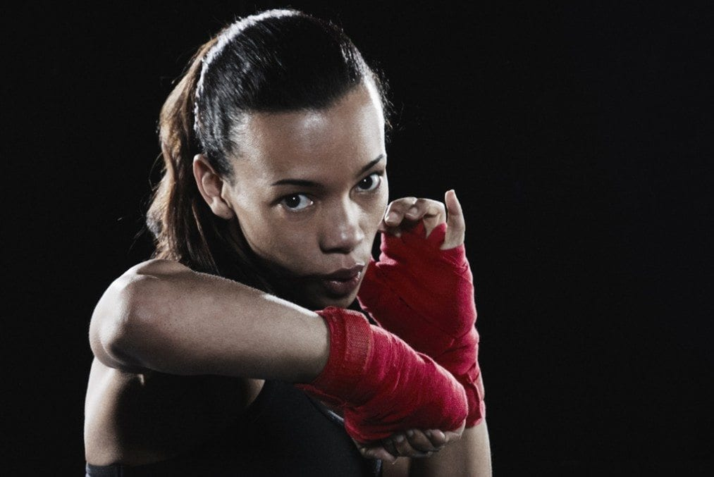 female boxer shadow-boxing