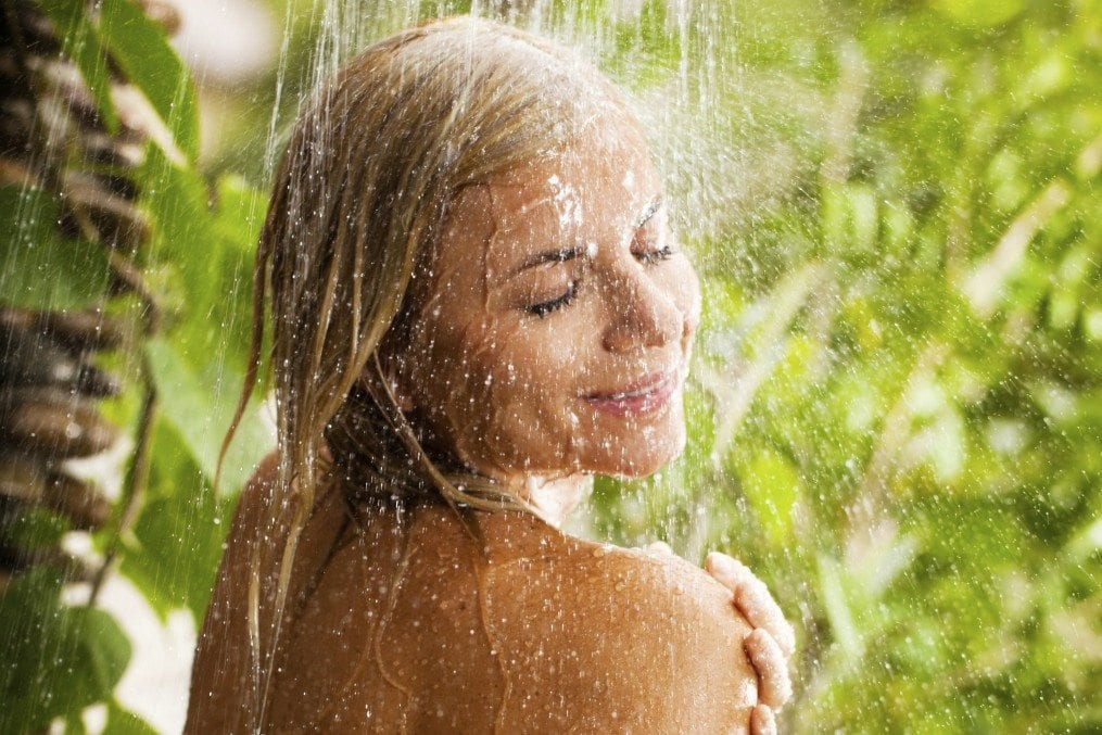 woman taking shower outsidoors
