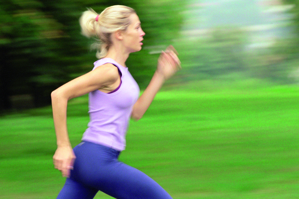 Woman Running, Side View, Blurred.