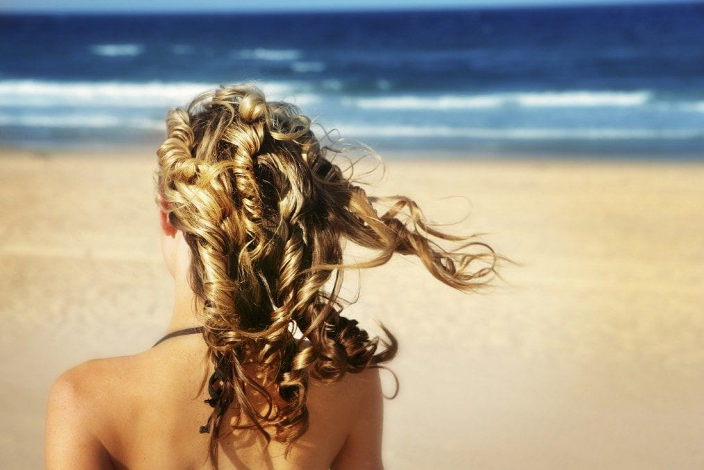 woman with lovely hair on beach