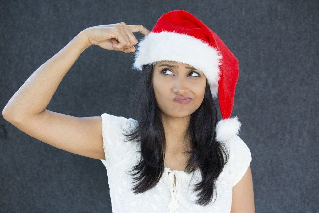 confused woman with santa claus hat
