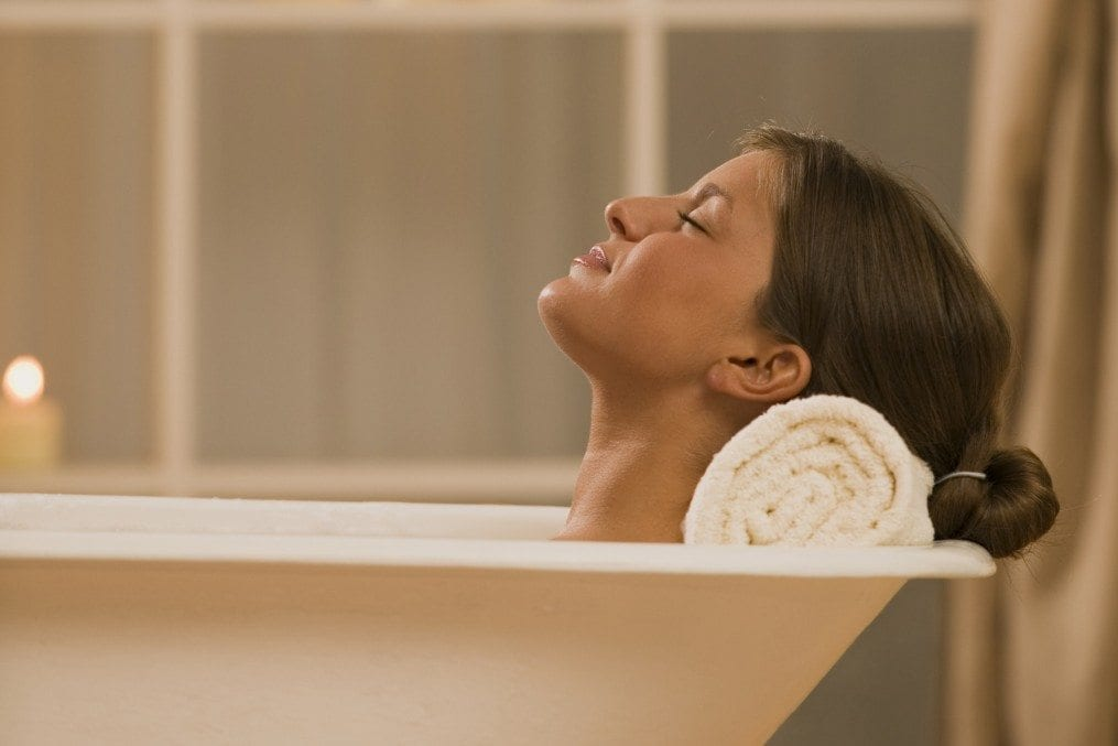 Woman soaking in bathtub