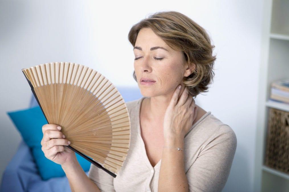 mature woman fanning herself