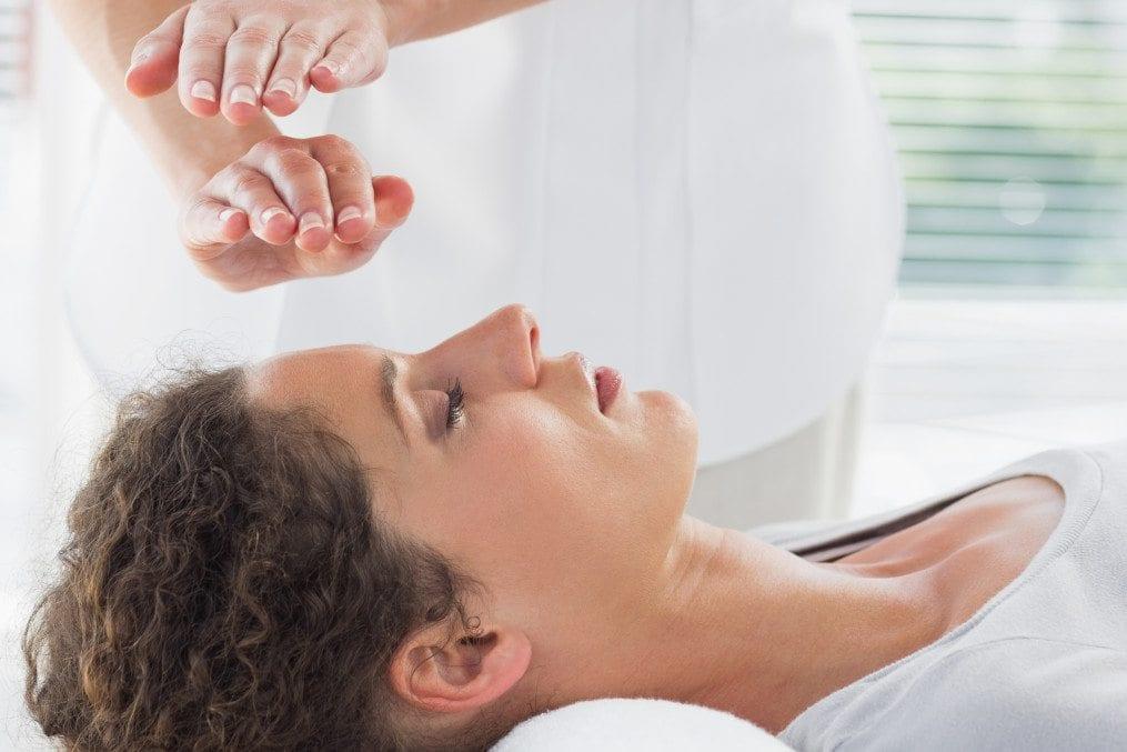 Woman getting Reiki treatment