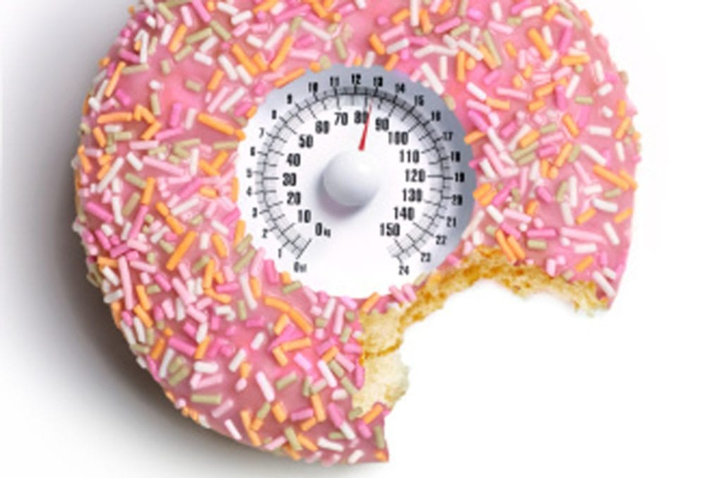 Doughnut with bite out and weighing scales