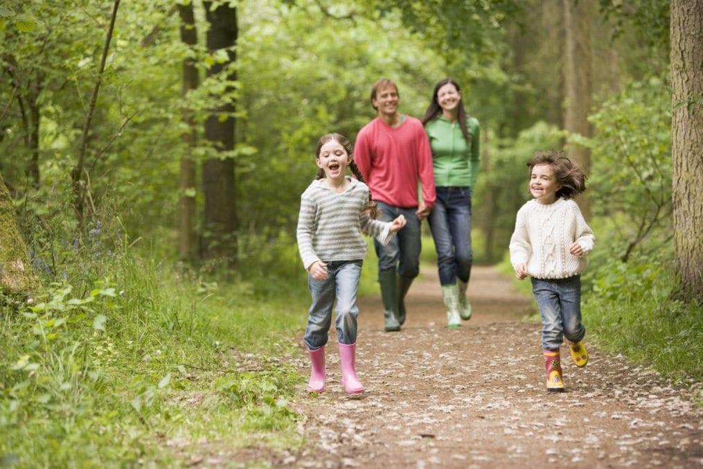 family walking through woods