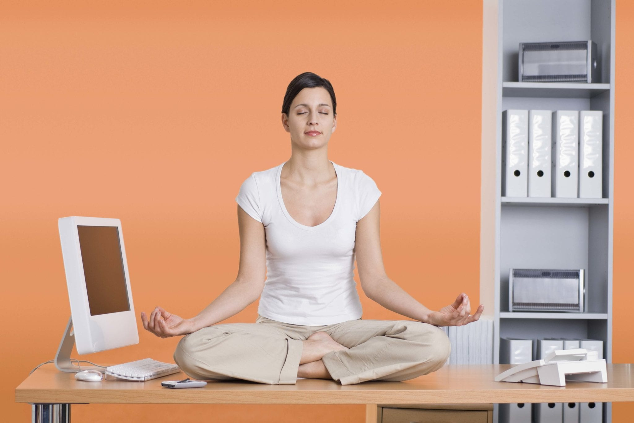 Woman doing yoga at desk