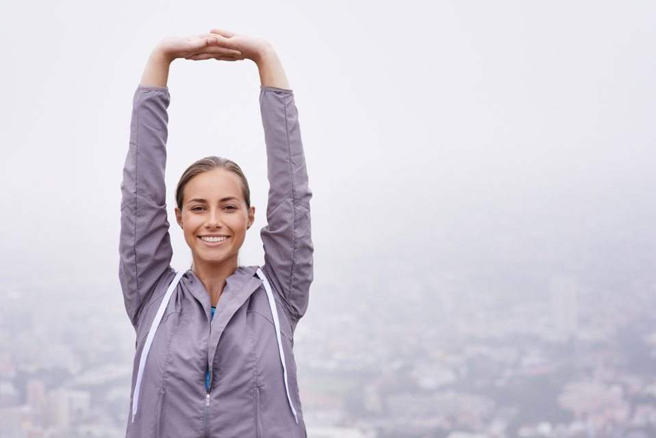 Happy woman smiling while stretching