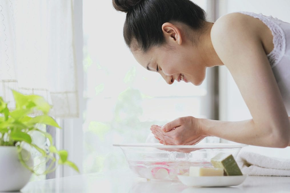 Skincare young woman washing face