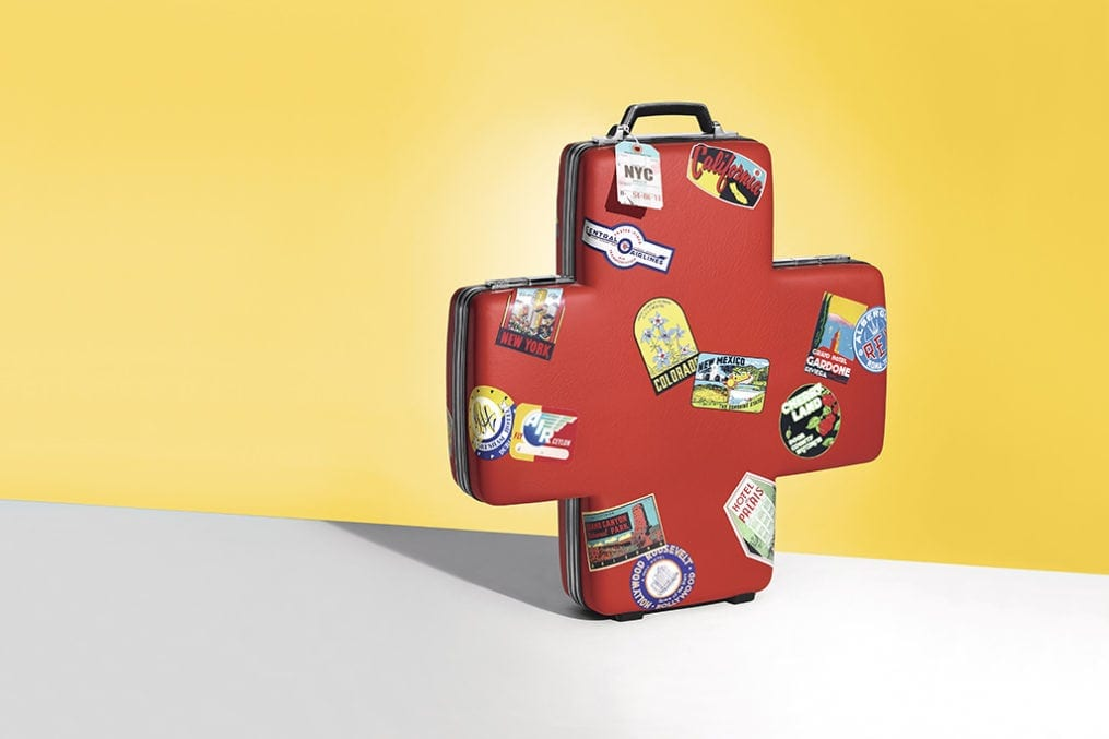 Suitcase shaped like a first aid symbol