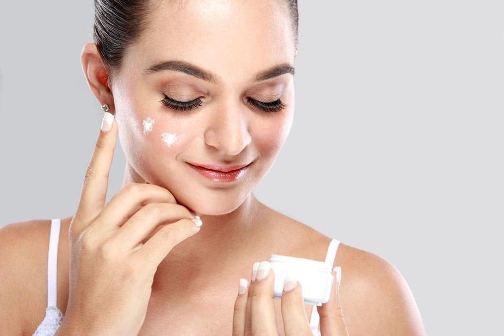 Skincare - Woman applying moisturiser