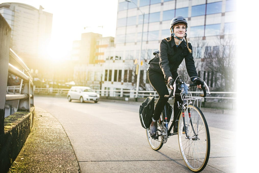A woman commuting on an e-bike