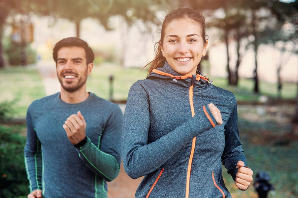 Active Iron - man and woman jogging
