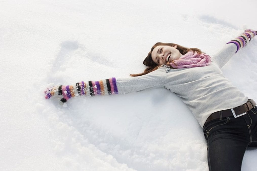 Woman creating a snow angel