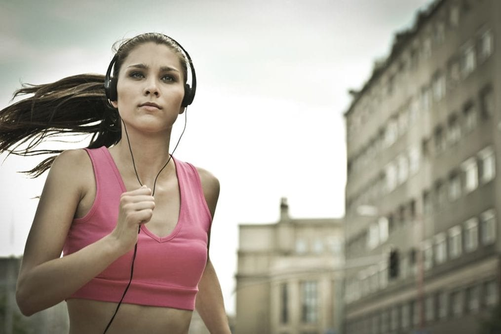woman running with headphones on