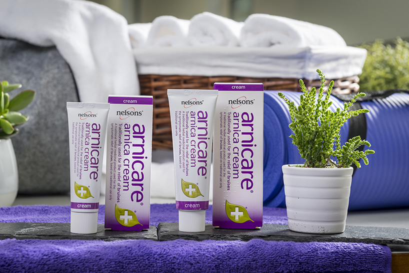 Spa setting showing the Nelsons Arnicare arnica cream range which helps heal bruises