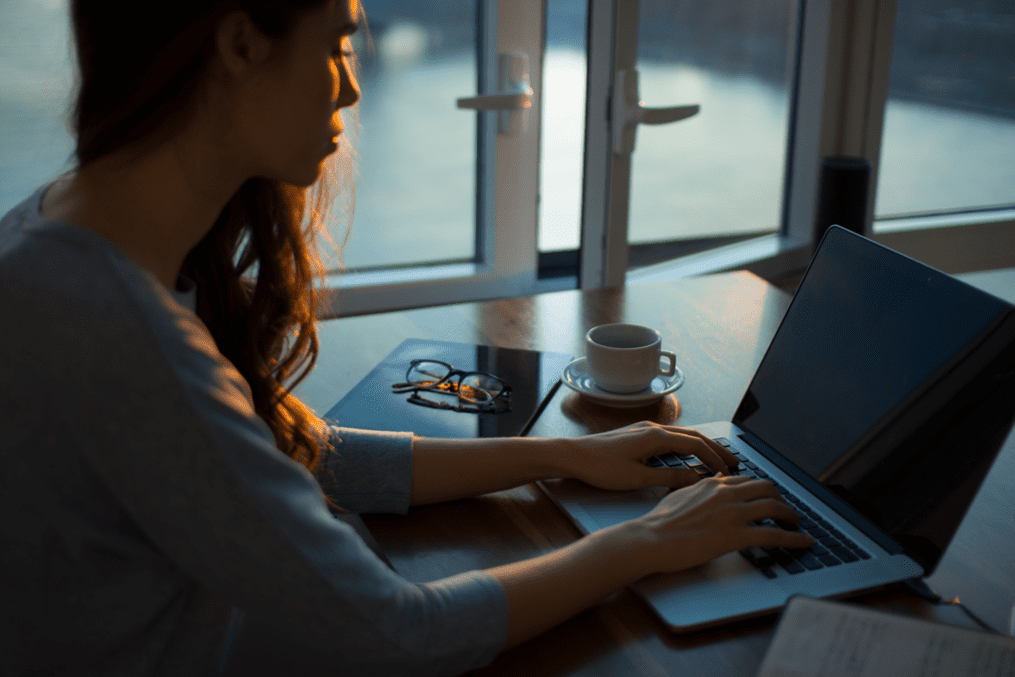 woman working on laptop - Imposter Syndrome