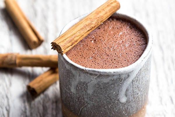 hot chocolate and cinnamon sticks