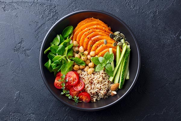 Plate with vegetables and other healthy foods