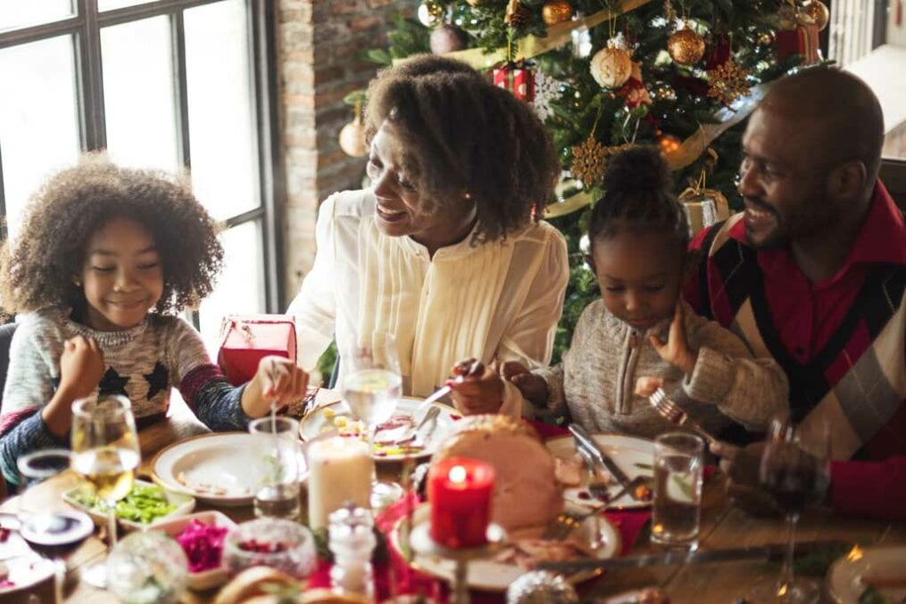 Family around the table at Christmas